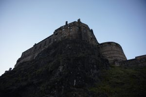 Looking up at Edinburgh Castle sat high on a cliff.