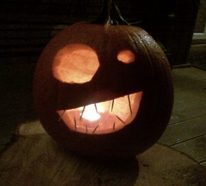 A lit carved pumpkin ready for Halloween.