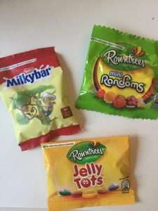 A selection of three types of British candy given out at Halloween.