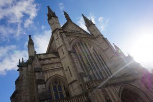 The bright sun shining on the cathedral in Winchester, England.