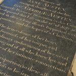 The black inscribed tombstone of Jane Austen.