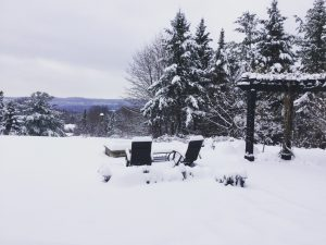 A backyard is covered in thick white snow during Christmas in Canada