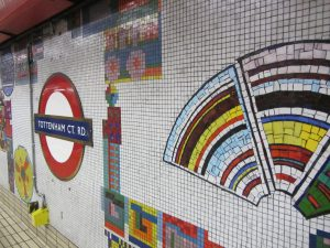 The colourful mosaic-tiled wall of the Tottenham Court Road Underground station in London, England.