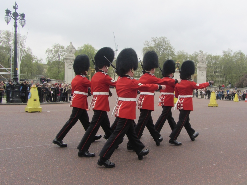 A group of royal guards march towards Buckingham Palace in London, England.