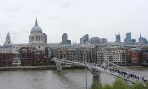 The view of the Millennium Bridge in London, England over the Thames River