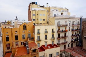 Multi-colours buildings of Barcelona stand in the distance