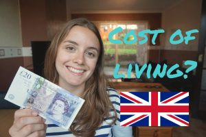 A girl holding up a 20 pound note